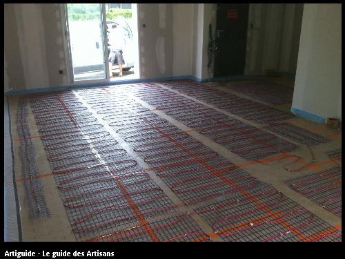 Réalisation d'un plancher chauffant électrique d'une maison à Besné